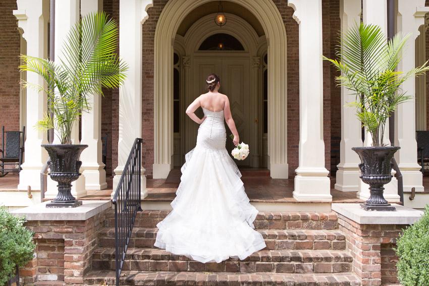 bride-on-steps-of-oaklands-mansion.jpg