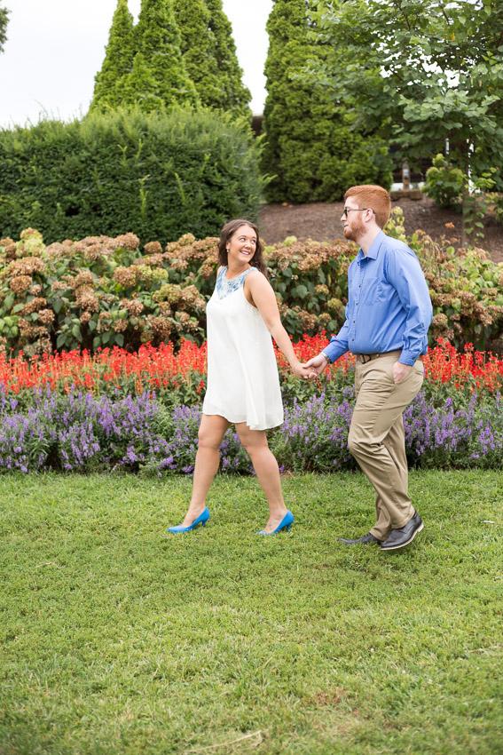 couple-walking-centennial-park-engagement.jpg