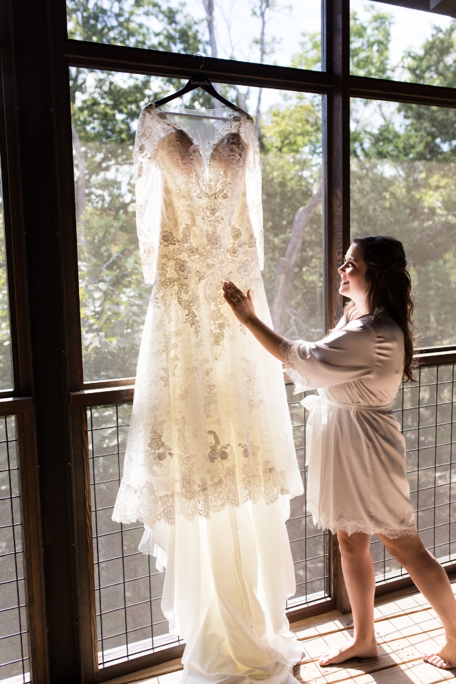 bride-reaching-for-wedding-dress.jpg