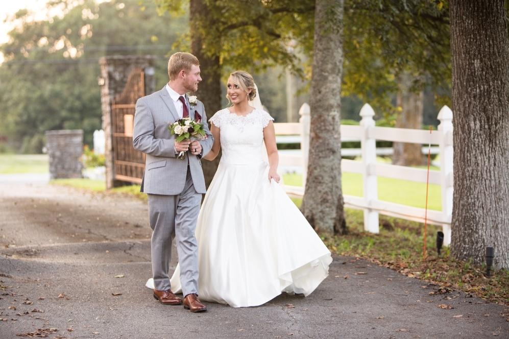 bride-and-groom-walking-legacy-farms-nashville.jpg