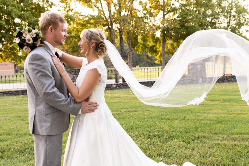 bride-and-groom-veil-blowing.jpg