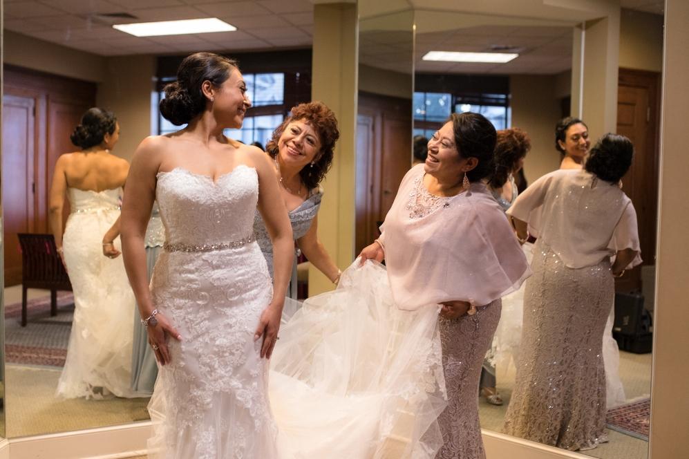 bride-getting-into-dress.jpg