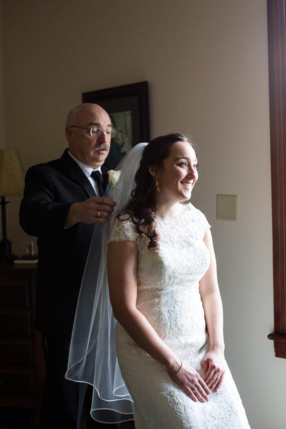 dad-helping-put-on-wedding-veil.jpg