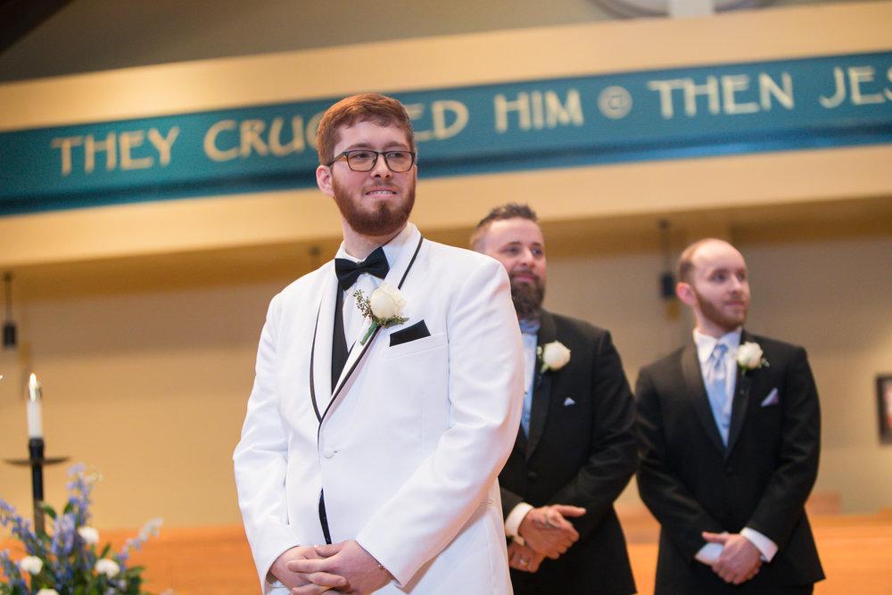 groom-seeing-bride-enter-church.jpg