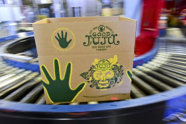 A box on an assembly line at Longmont's Left Hand Brewing. The company announced Wednesday that it would begin offering its craft brews in cans. (  Matthew Jonas / Staff Photographer  )