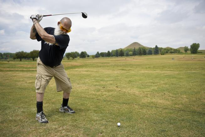 Michael A. Masias spends time on the driving range at Haystack Mountain Golf Course in Niwot on Friday. Masias said he first golfed at Haystack, which this year is celebrating its 50th anniversary, in 1977. (  Lewis Geyer / Staff Photographer  )