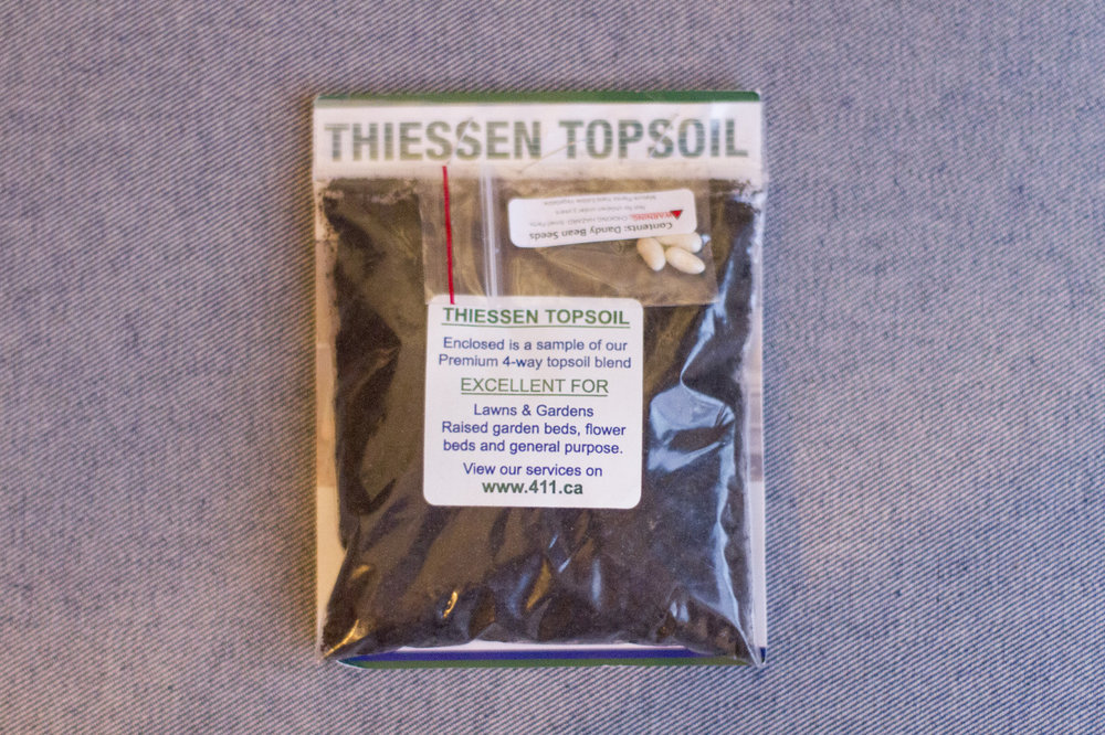 Now this is the type of advert I like.  A bag of dirt and some seeds.  Thanks Theissen Topsoil!