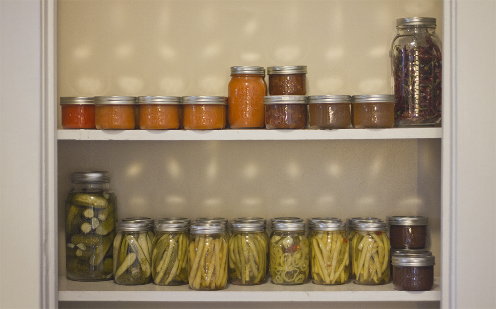 We're going to need some more shelves.    (top left to right) - Cayenne pepper sauce, peach and habanero hot sauce, peach and walnut conserve, trail apple jelly, dried cayenne peppers   (bottom left to right) - Dill pickles, deli-sliced pickles, pickled beans, pickled banana peppers, spicy pickled beans, apple butter.