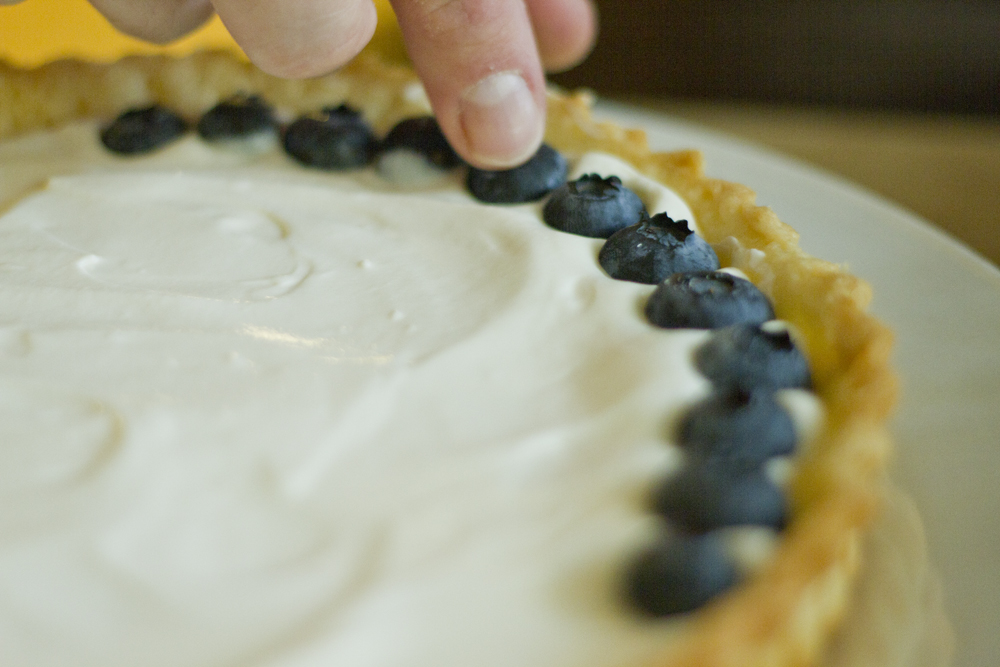 This weekend's discovery was that fruit tarts are delicious and pretty easy to make.  It's just a basic pie crust, some sort of filling, and fresh fruit.   For our filling, we whisked together ½ cup cream cheese, ½ cup heavy whipping cream, 1 tsp sugar, and ½ tsp vanilla extract.     The perfect dessert to use up your summer bounty.