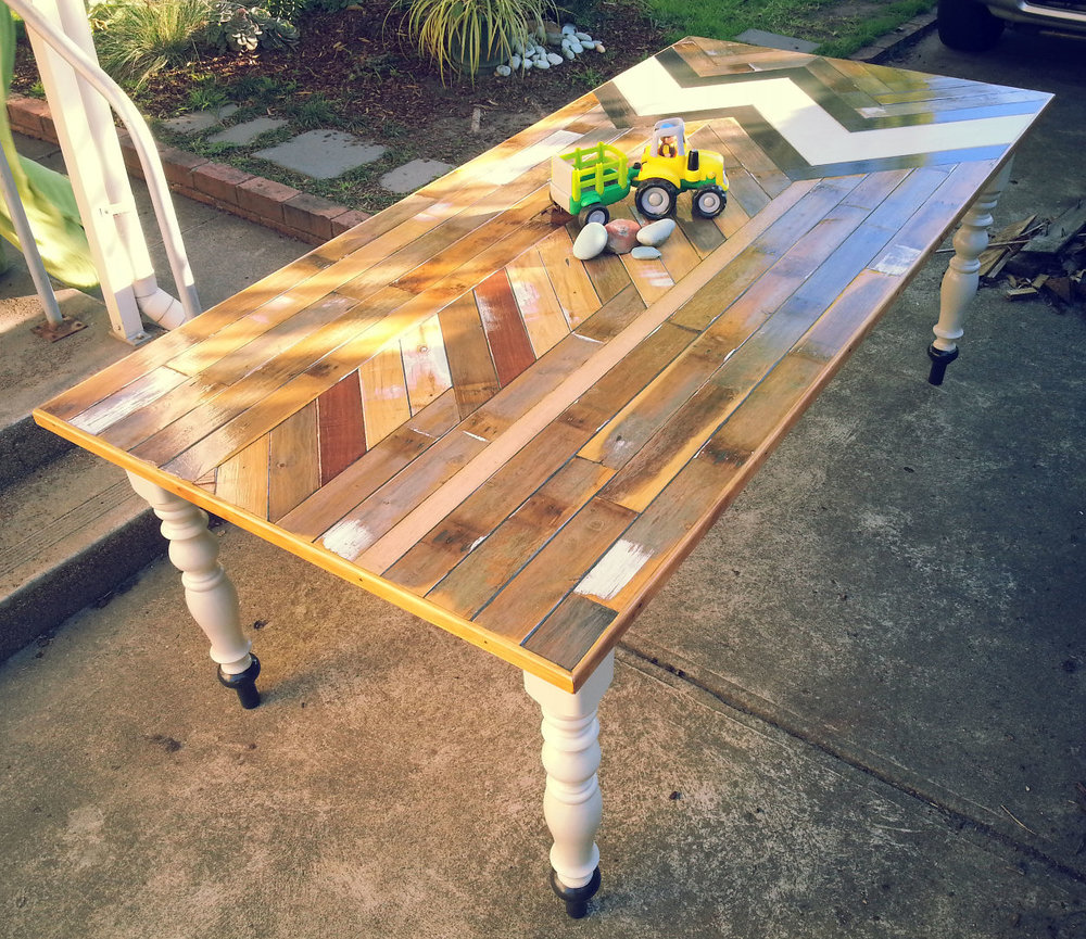 BIN 3    Size : 2500 x 1000  Materials : Reclaimed Jarrah, Cypress and Vic Ash, Coffee stained edging, reclaimed turned legs, acrylic. Finished in a low VOC gloss varnish.