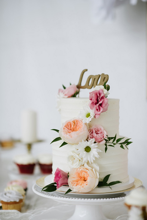 white wedding cake with flowers.jpg
