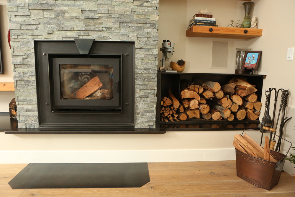 industrial metal and stone fireplace.jpg