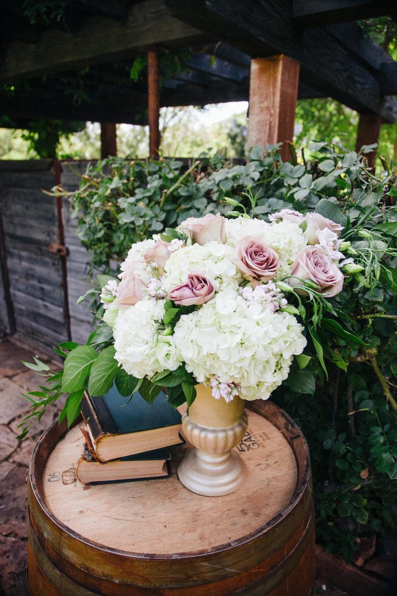 wine barrel alter flowers.jpg