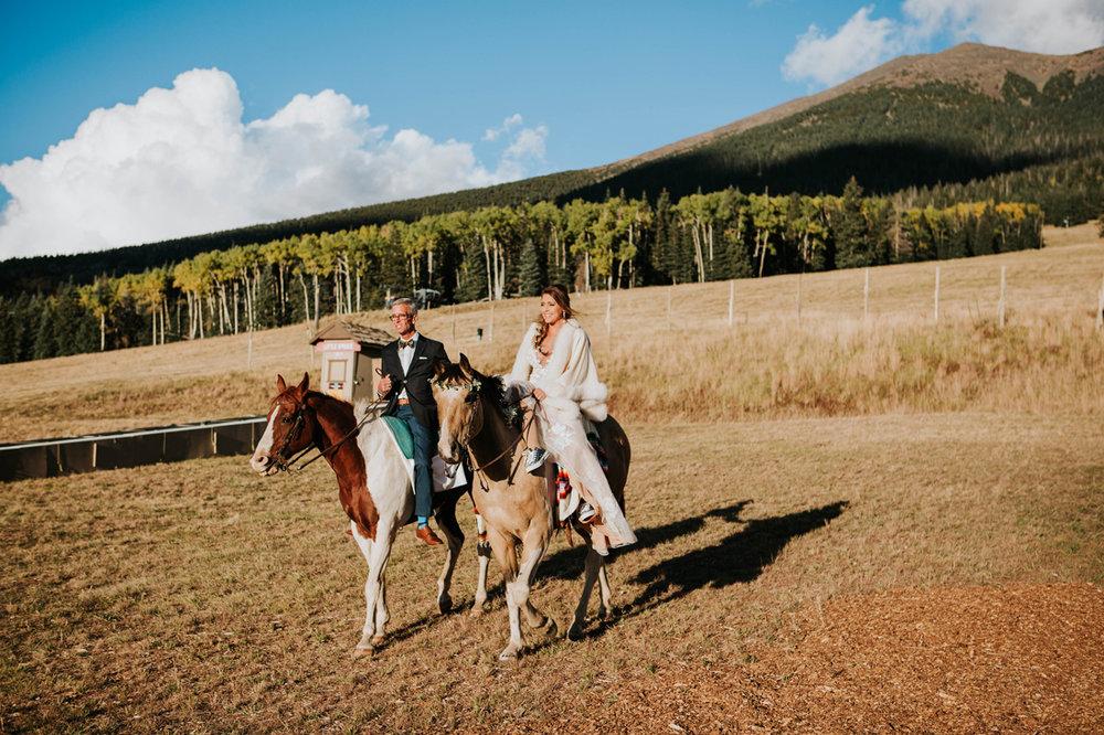 bride rides in on horse.jpg