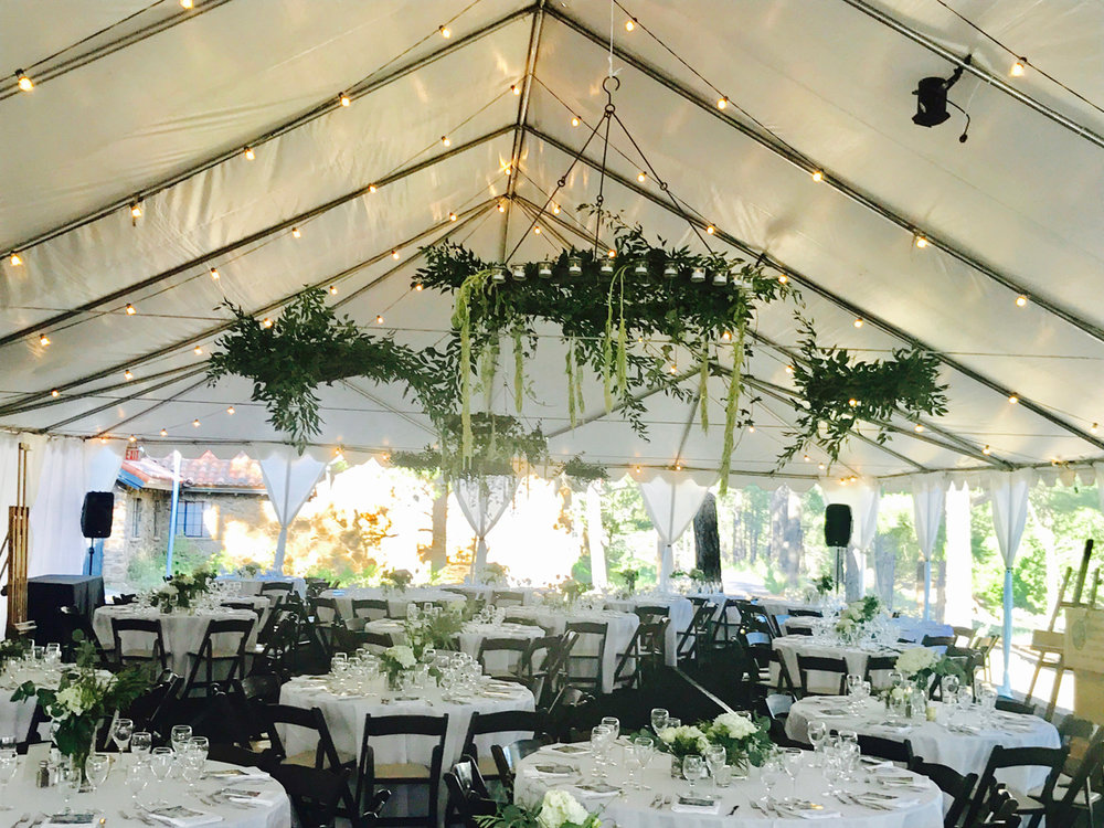 tented event with hanging floral.jpg