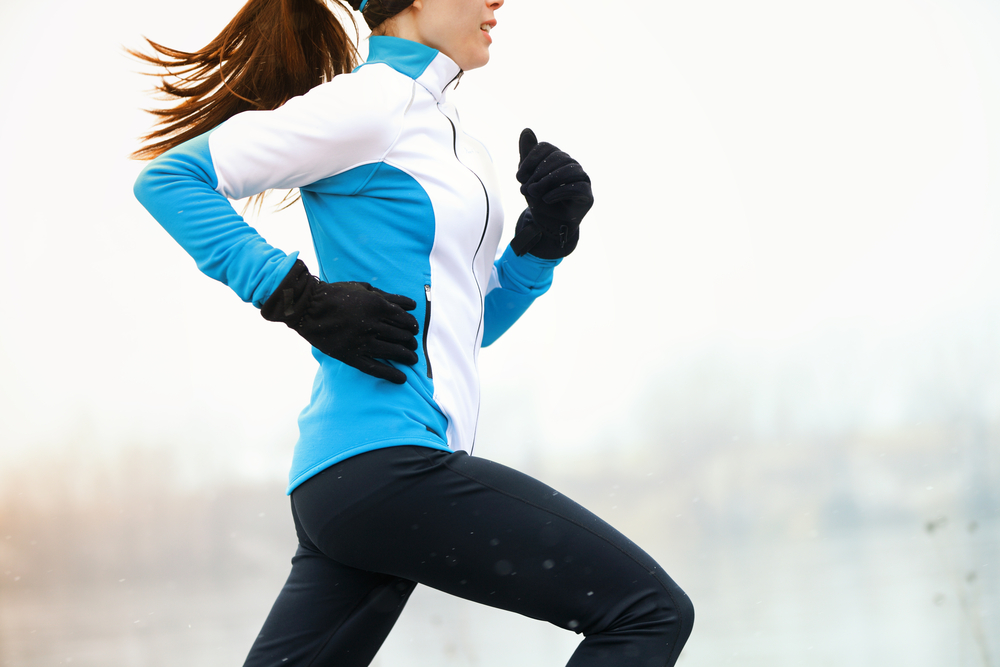 Woman running in winter training clothes