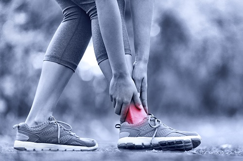 Female runner feels pain in her ankle
