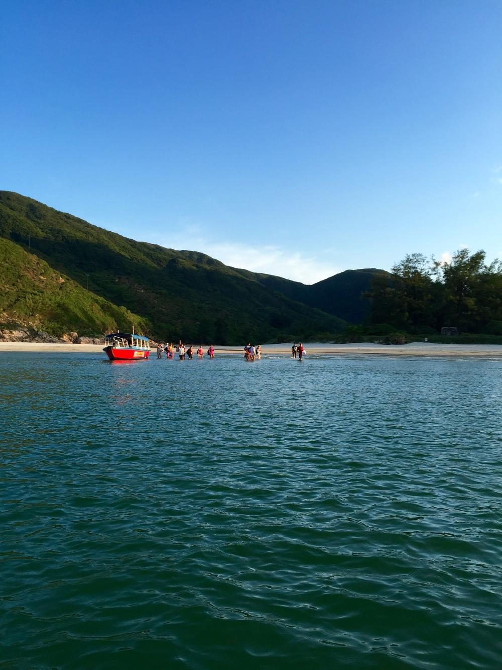 Beachgoers boarding the water taxi.