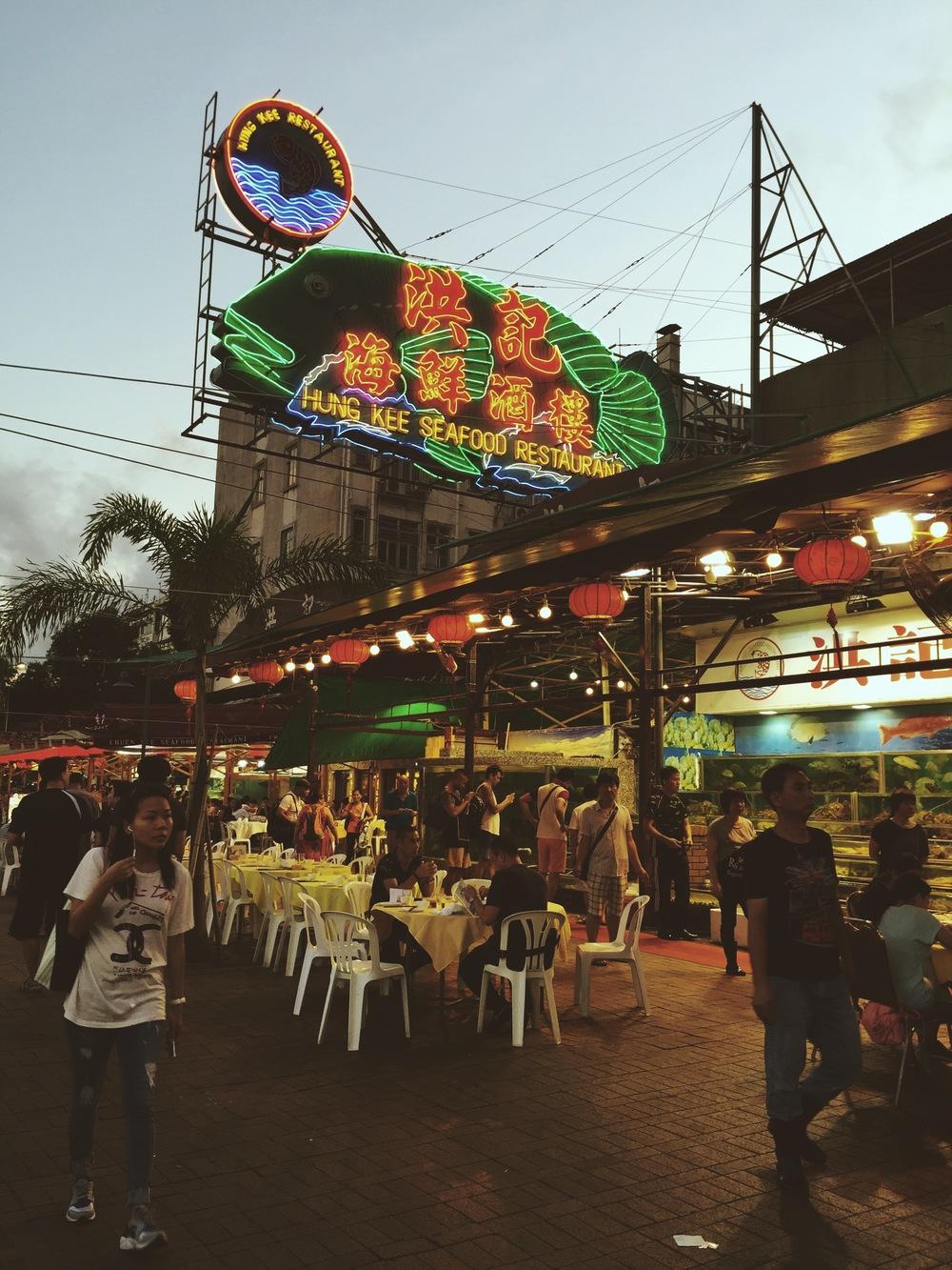 Open-air seafood restaurants line the boardwalk.