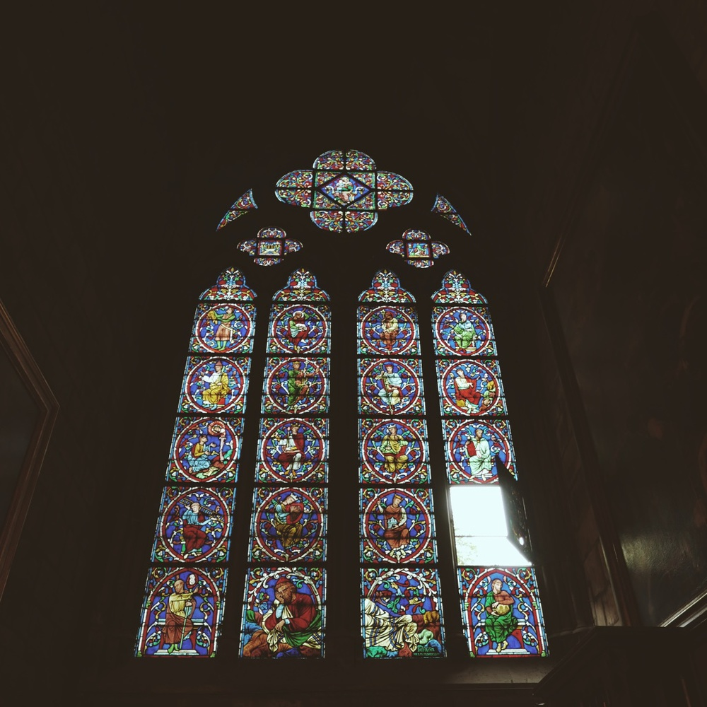 Completely mesmerized by the cathedral's stained glass windows.