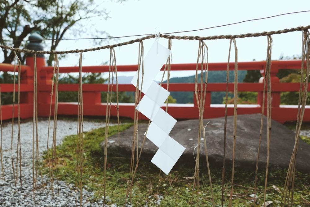 A Shimenawa (enclosing rope) marking a sacred stone.