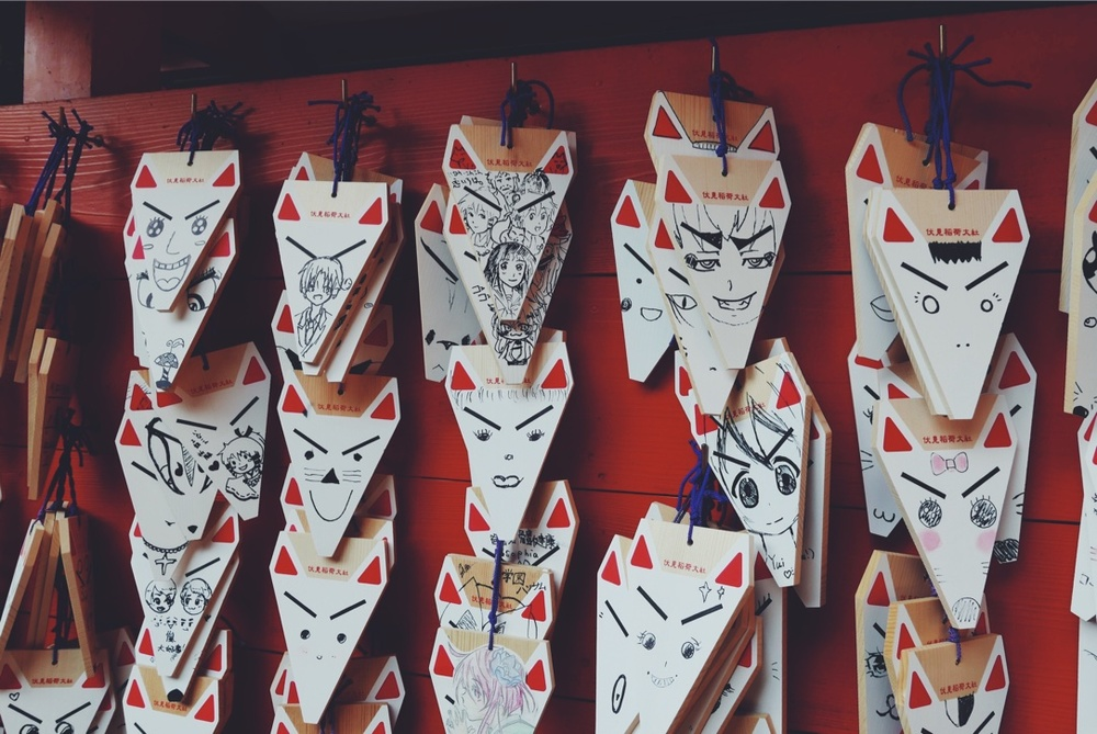 Fox-shaped emas (plaques for prayers and wishes) at  Fushimi Inari-taisha .