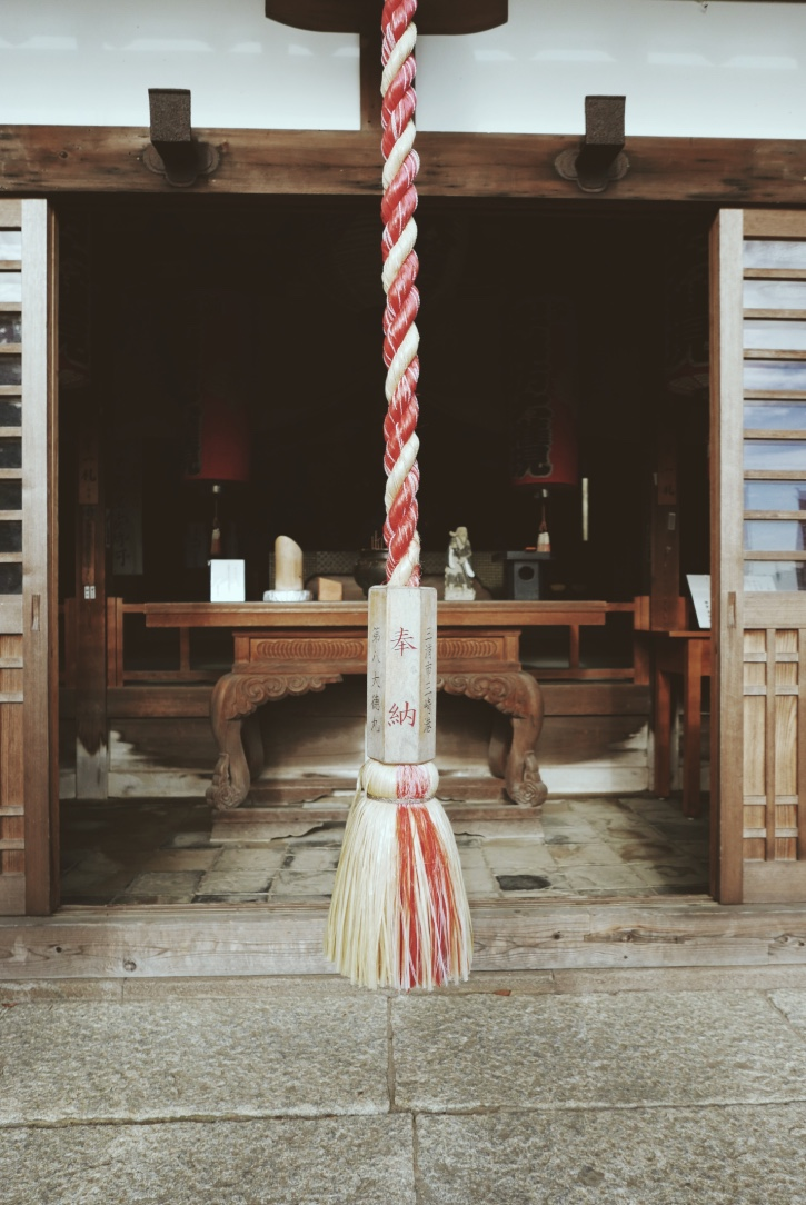 A rope with which to sound the gong and get the kami's (Shinto god's) attention at Hans-bo.