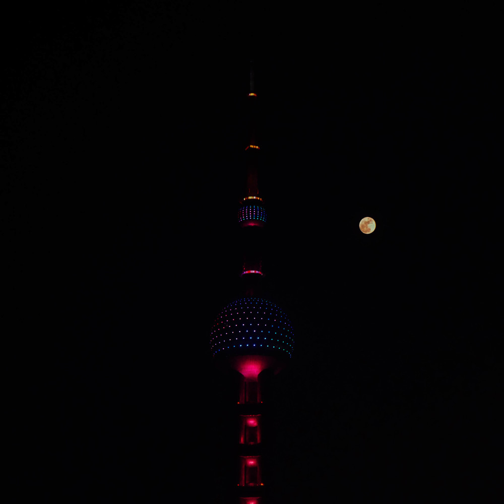 A full moon over the Oriental Pearl Tower.