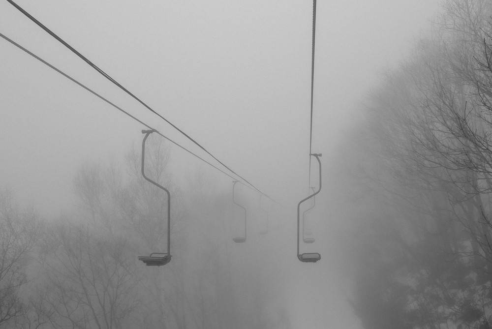 An eerie solo chair lift.