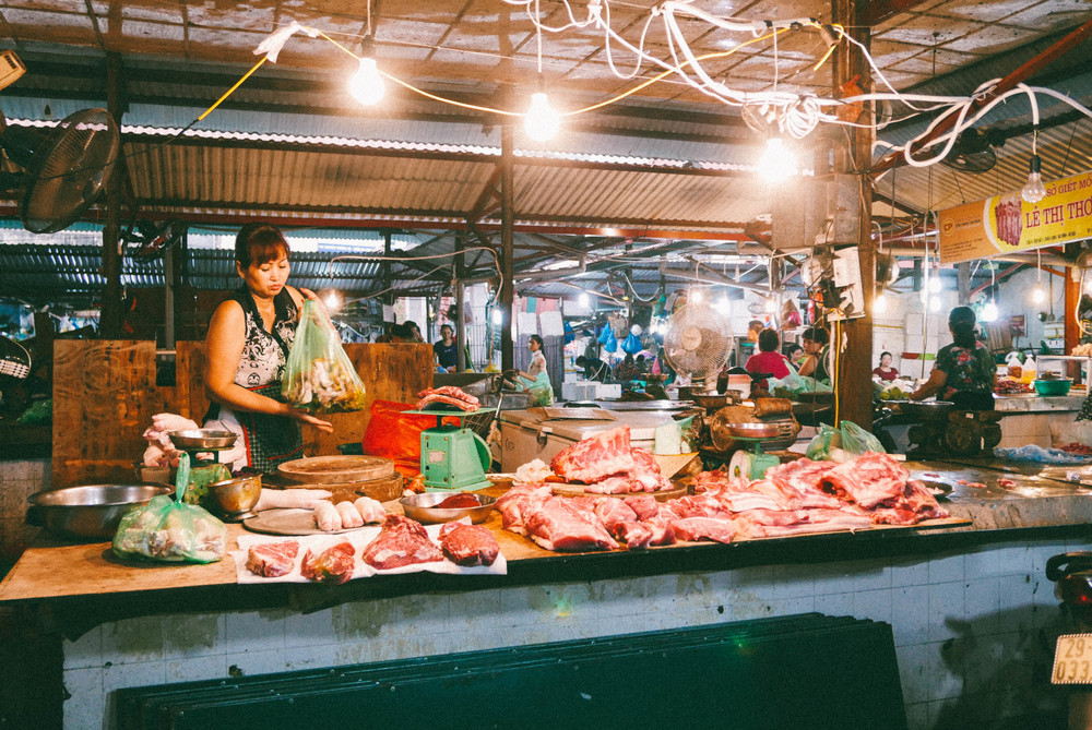 A meat vendor at the market.