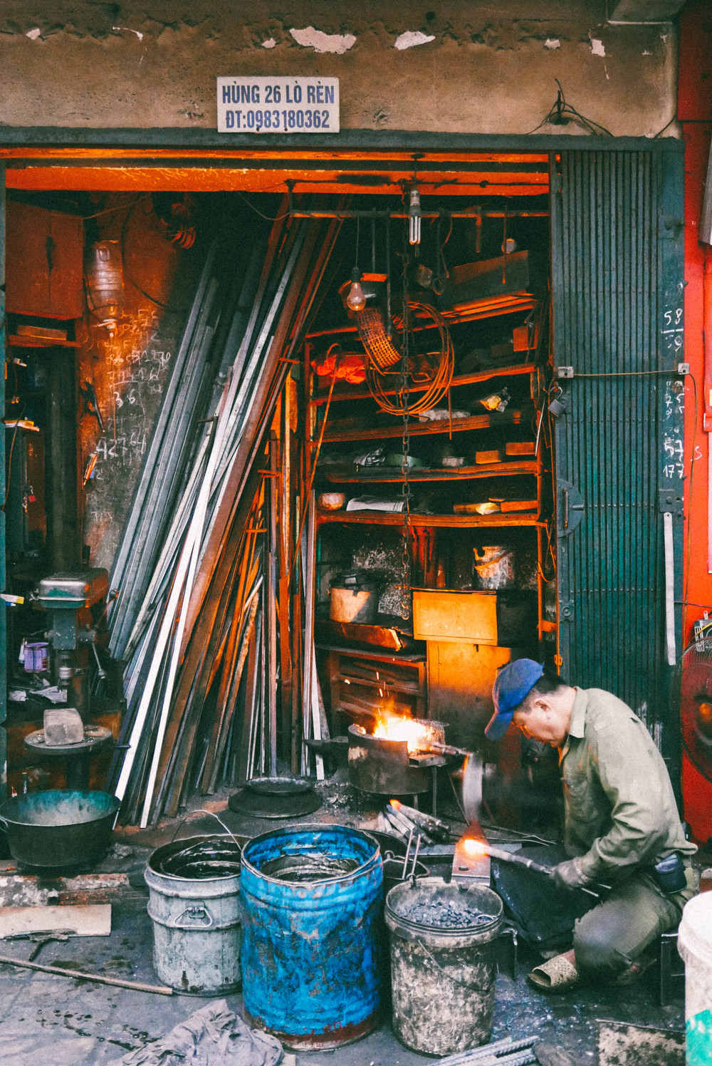A metalworker on the street in Hanoi's Old Quarter.