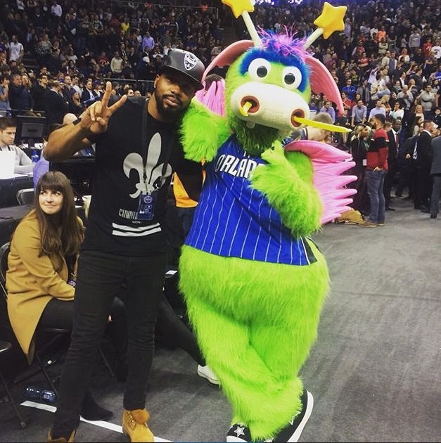 BBC 1Xtra Radio Presenter Nesta McGregor and the Orlando Magic mascot court side