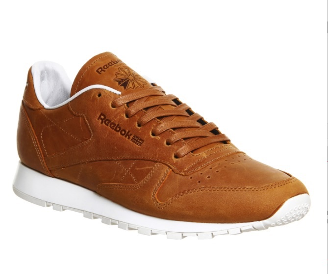 Reebok CL Leather gets a premium lift this spring featuring a rust biege lux Pw leather upper and a Contrasting white rubber sole.