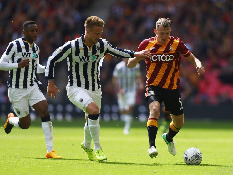 Millwall Defender Byron Webster keeps a close eye on Bradford's marksmen Billy Clarke