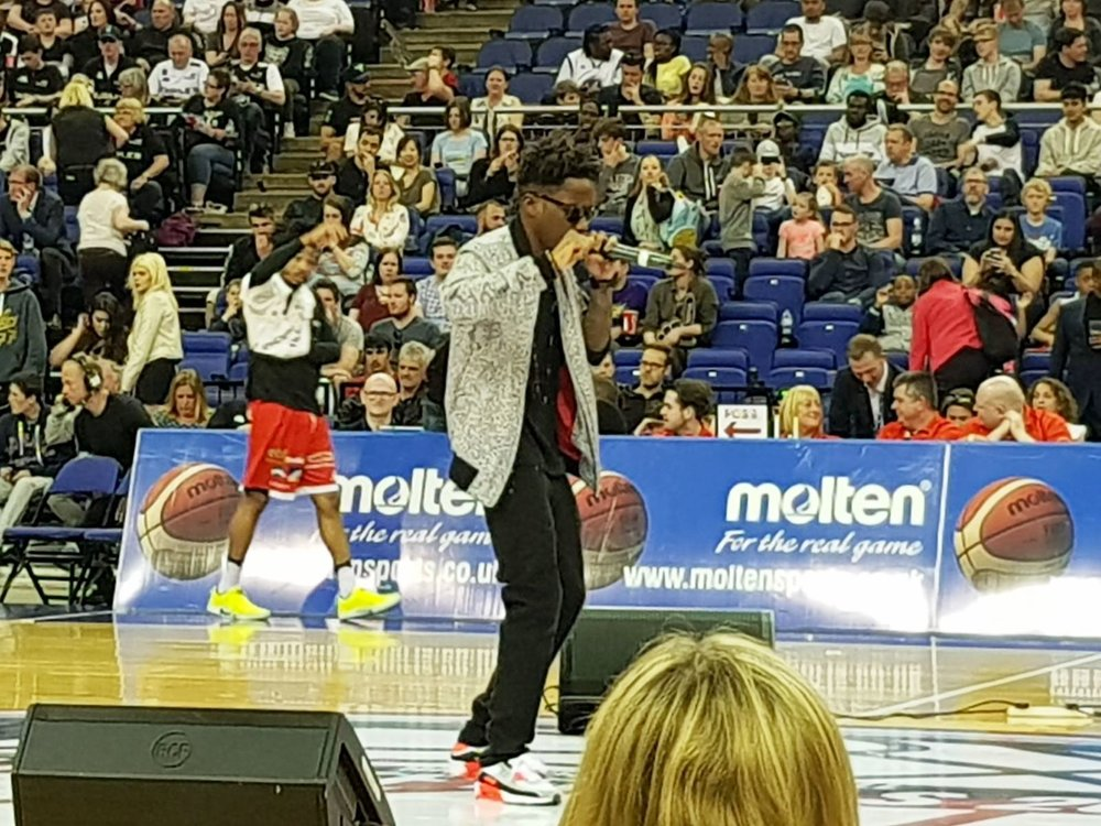 Tinchy Stryder entertains the crowd at half time with some of his chart hits