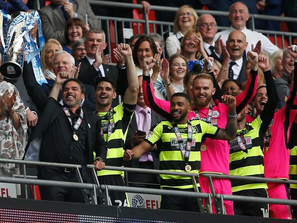 Huddersfield Town Head Coach David Wagner lifts trophy with players