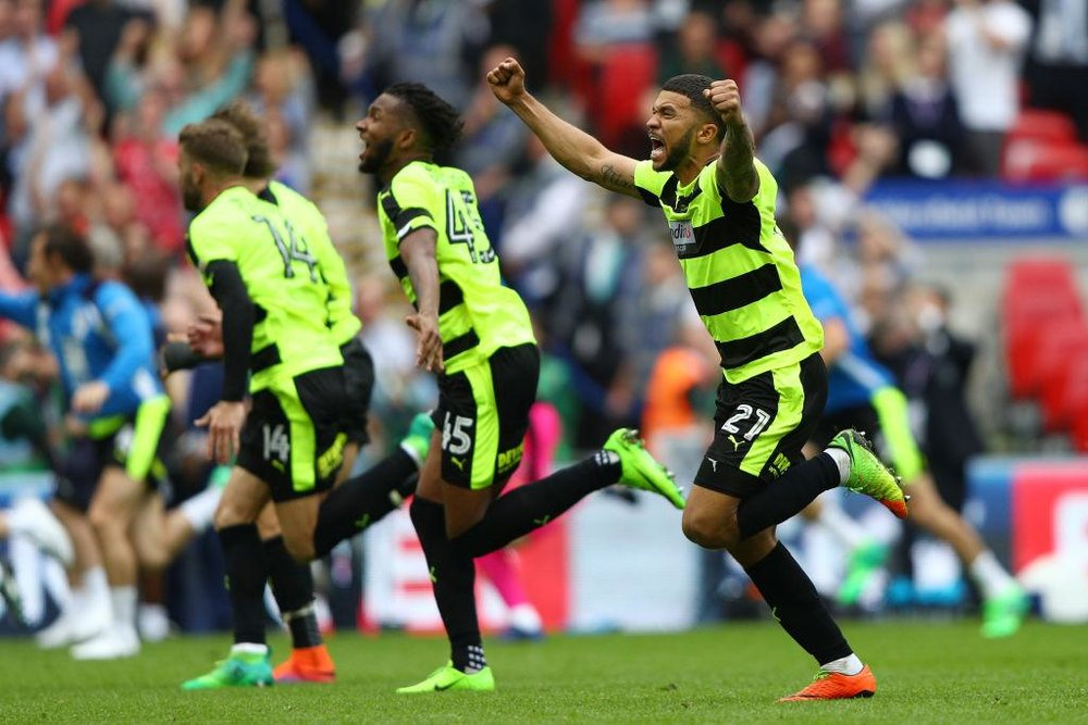 Huddersfield players celebrate with fans