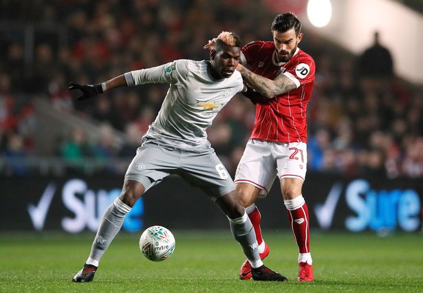 Left: A tightly marked Paul Pogba failed to impose himself on the game on his return to action.