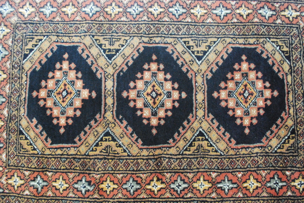 "An example of our 24"" x 36"" size CarpetRides rugs for the trunk / SUV cargo area. The particular rug is home in a Denali."