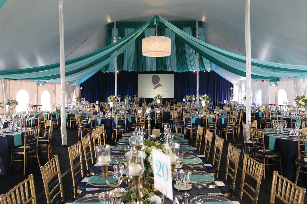 University of Virginia Darden Business School tent event with custom fabric swags and projection