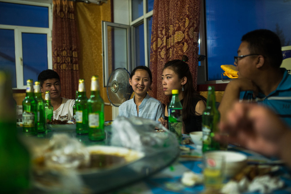 Xin'e Oroqen Settlement, August 2017   Oroqen youth and their friends from other ethnic groups – Mongolian, Han, Daur and Ewenki, eat together during a summer break. Life for these young people is dramatically different to that of the generations preceding them and many now attend universities across China or follow their parent into roles within local government.