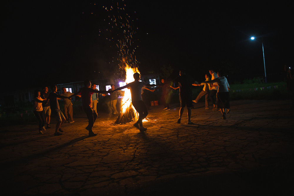 Heilongjiang Province, August 2017  Visiting university professors from Harbin take part in a fire ritual put on as a show by local Oroqen entrepreneurs. Interest in an ethnographically focused tourism industry and folk rituals are growing across contemporary China.