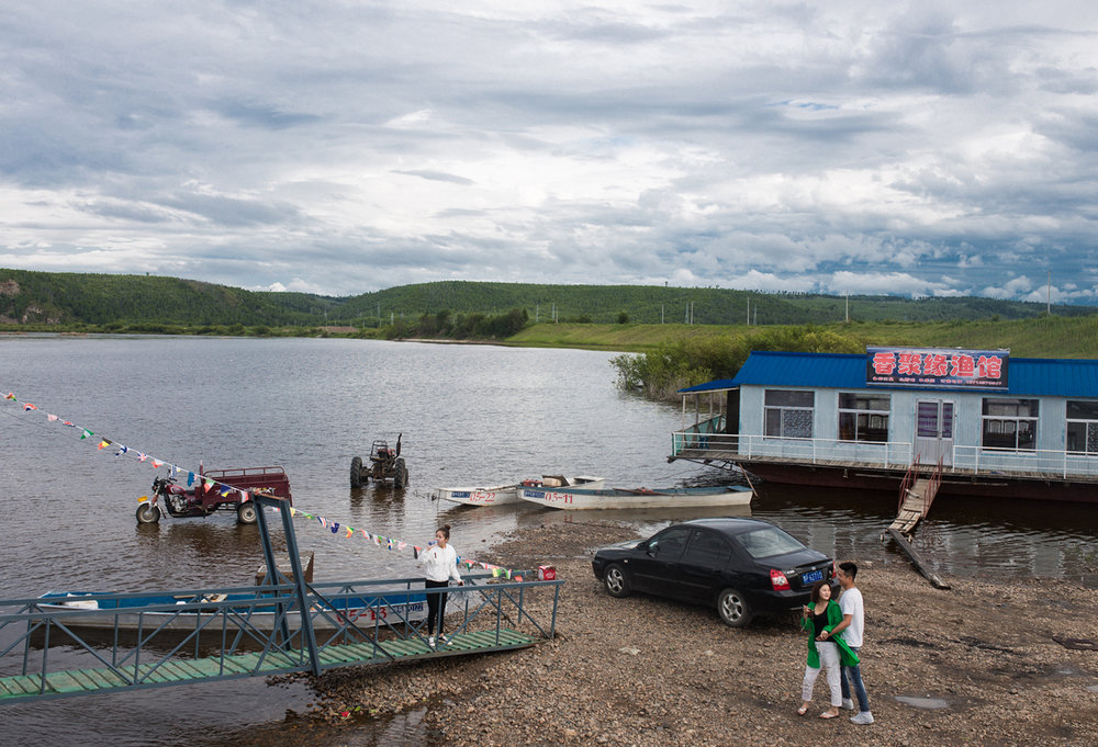 Heilongjiang River, August 2017  Young Oroqen depart after lunch on a restaurant on the river. The Heilongjiang (or Amur in Russian) acts as the border between China and Siberia and historically Oroqen and many other ethnic groups moved between the two regions.