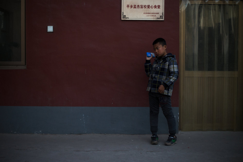 "Mingming, Hebei Province 2017  ""Before we had these radios to listen to stories I used to miss my Mum and Dad and sometimes cry secretly at night. Now I listen to the radio. I often fall asleep to the stories and don't cry anymore."""