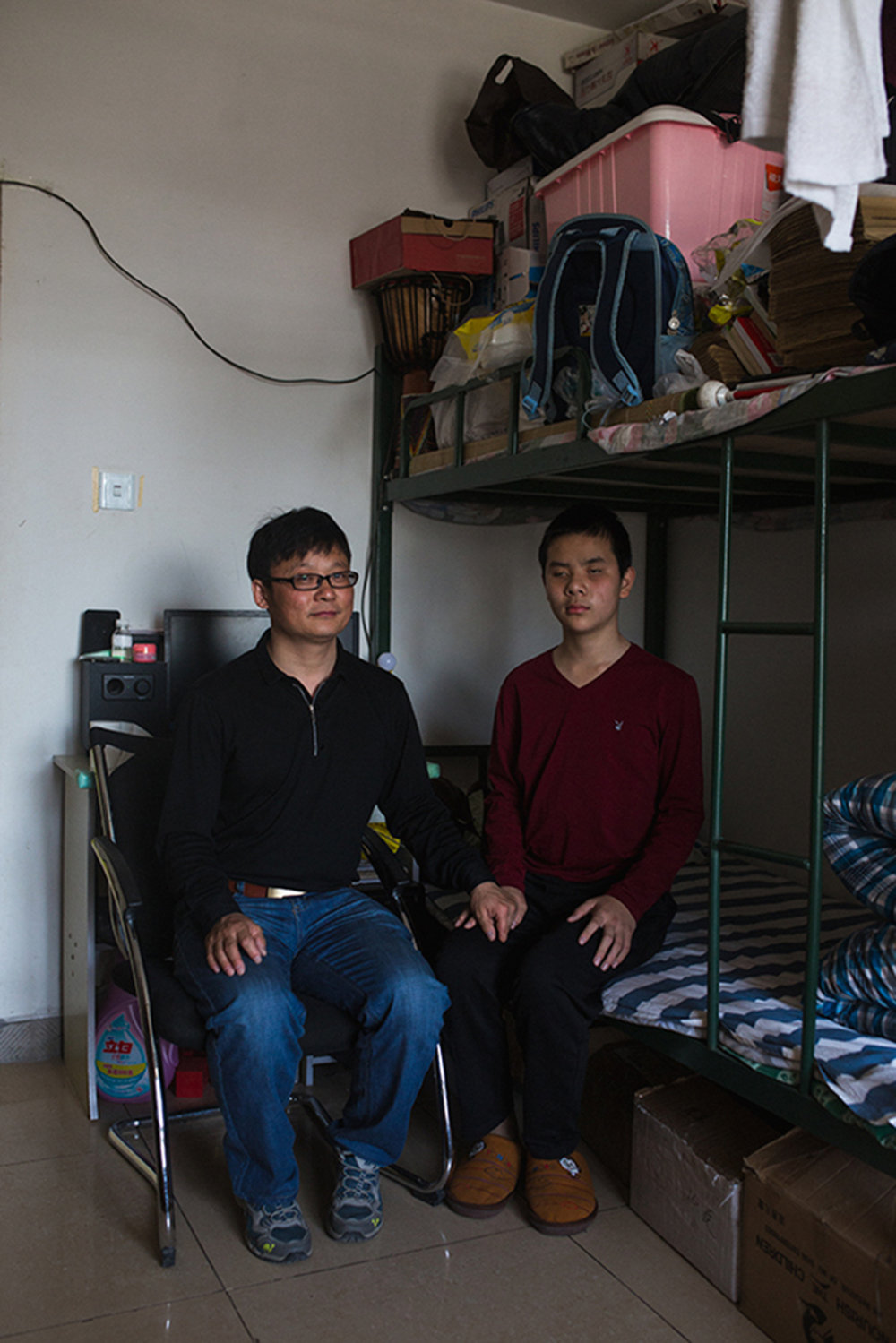 "Wang Guoming and his father, Beijing 2017   ""Guoming was 7 years old and needed to go to school. There is a blind school in our hometown but...I wanted Guoming to get a better education here"""