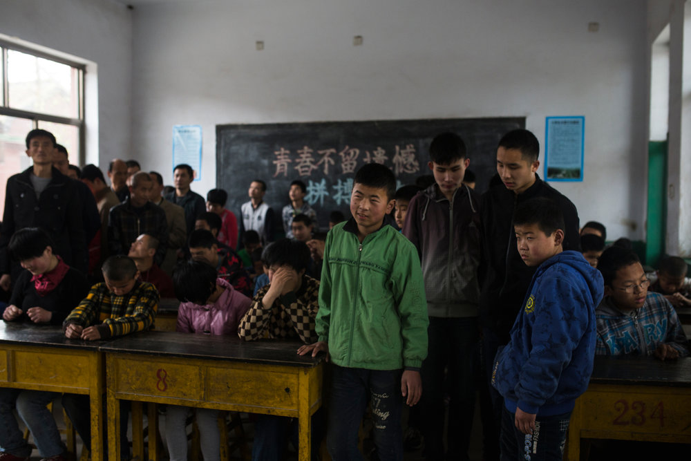 Mu Mengjie School for the Visually Impaired, Hebei Province 2017  Children gather in the classrooms for morning lessons. Shungze, 16 (in green) dreamt of working in a traveling circus before his disability became too problematic for him to continue.