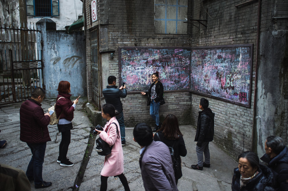 For now, Shibati acts as a laissez-faire tourist hub where street hawkers sell nostalgic paraphernalia and visitors take photographs among the ruins that will soon be replaced with tower blocks.   Chongqing, January 2017
