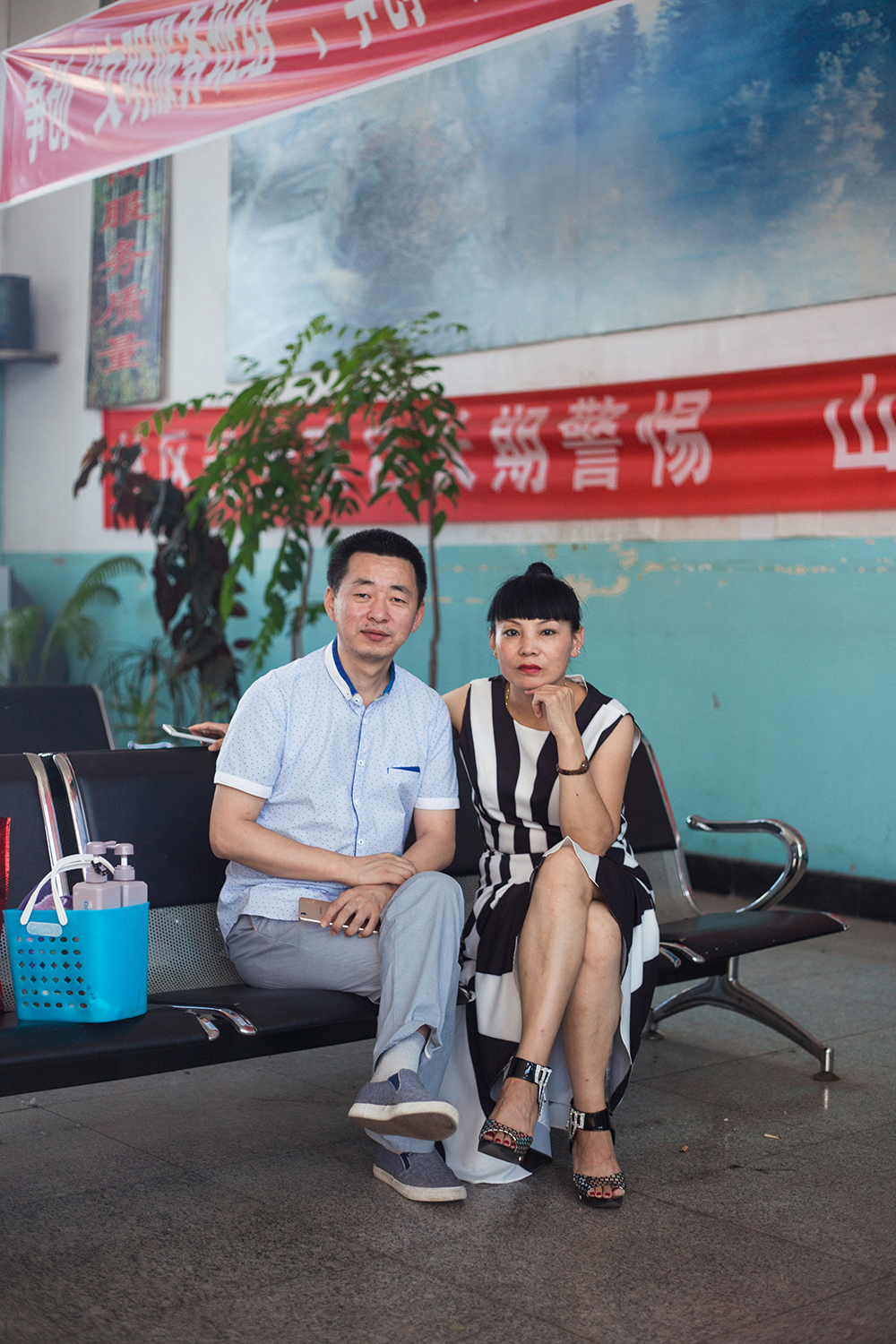 Couple in the bus station, Heilongjiang Province, China, 2017