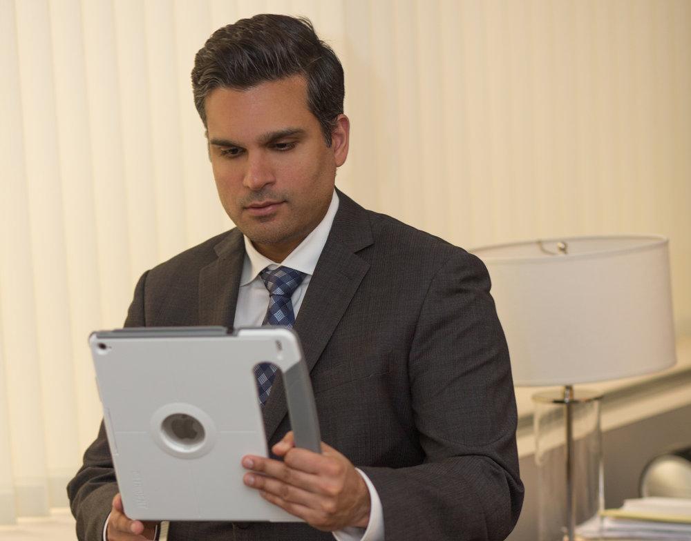 Dr. Omar P. Haqqani, MD conducting a telemedicine session.