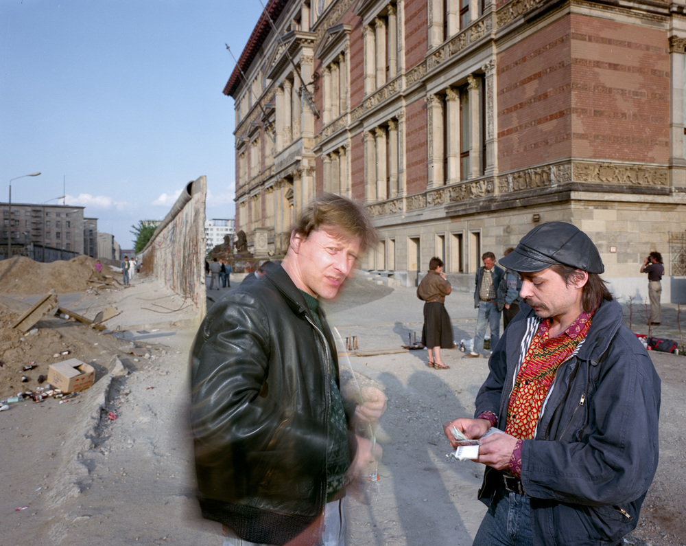 "A little docudrama - two men changing money near the wall behind Martin Gropius - Bau. Berlin 1990.         Normal   0           false   false   false     EN-CA   X-NONE   X-NONE                                                                                                                                                                                                                                                                                                                                                                                                                                                                                                                                                                                                                                                                                                                                                                                                                                                                   /* Style Definitions */  table.MsoNormalTable 	{mso-style-name:""Table Normal""; 	mso-tstyle-rowband-size:0; 	mso-tstyle-colband-size:0; 	mso-style-noshow:yes; 	mso-style-priority:99; 	mso-style-parent:""""; 	mso-padding-alt:0cm 5.4pt 0cm 5.4pt; 	mso-para-margin-top:0cm; 	mso-para-margin-right:0cm; 	mso-para-margin-bottom:8.0pt; 	mso-para-margin-left:0cm; 	line-height:107%; 	mso-pagination:widow-orphan; 	font-size:11.0pt; 	font-family:""Calibri"",sans-serif; 	mso-ascii-font-family:Calibri; 	mso-ascii-theme-font:minor-latin; 	mso-hansi-font-family:Calibri; 	mso-hansi-theme-font:minor-latin; 	mso-fareast-language:EN-US;}"
